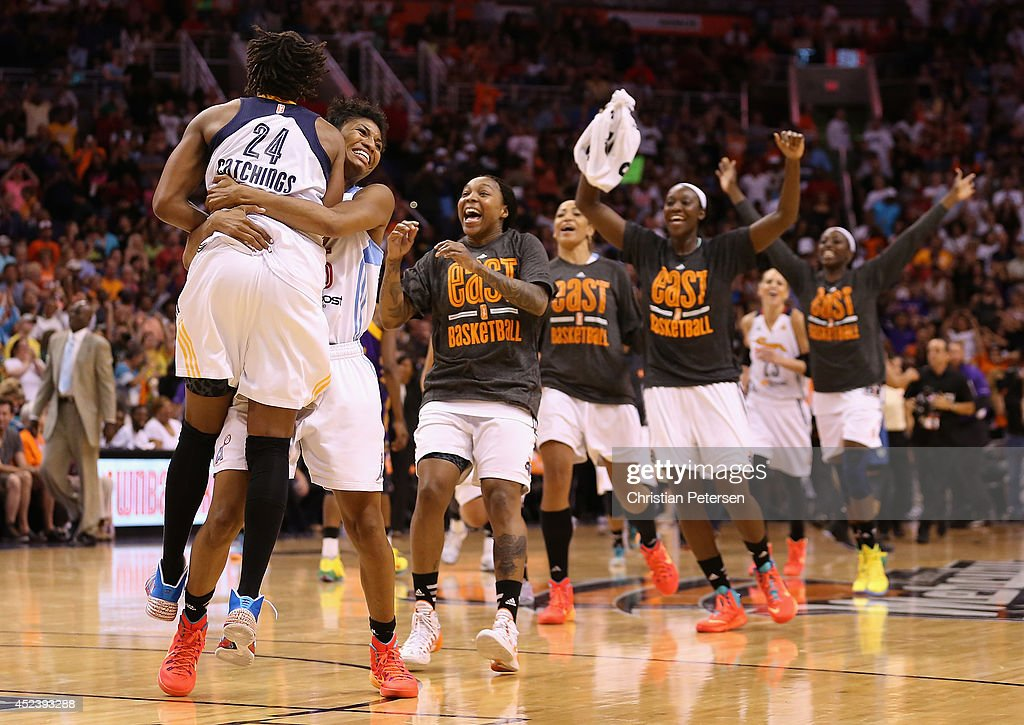 Eastern Conference All-Star Angel McCoughtry #35 (second from left) of the Atlanta Dream and Tamika Catchings #24 (L) of the Indiana Fever celebrate after defeating the Western Conference All-Stars 125-124 in the WNBA All-Star Game at US Airways Center on July 19, 2014 in Phoenix, Arizona.