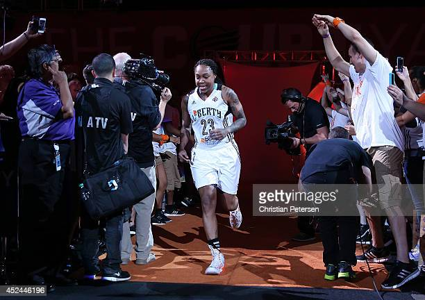 Eastern Conference AllStar Cappie Pondexter of the New York Liberty is introduced to the WNBA AllStar Game at US Airways Center on July 19 2014 in...