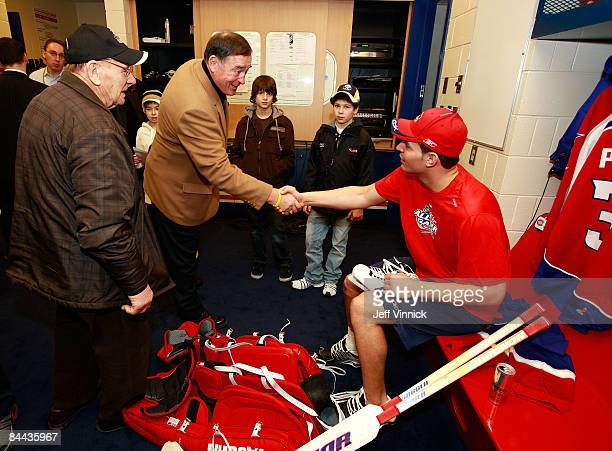 Eastern Conference AllStar Carey Price of the Montreal Canadiens greets NHL legend Johnny Bower and Frank Mahovlich in the locker room prior to the...