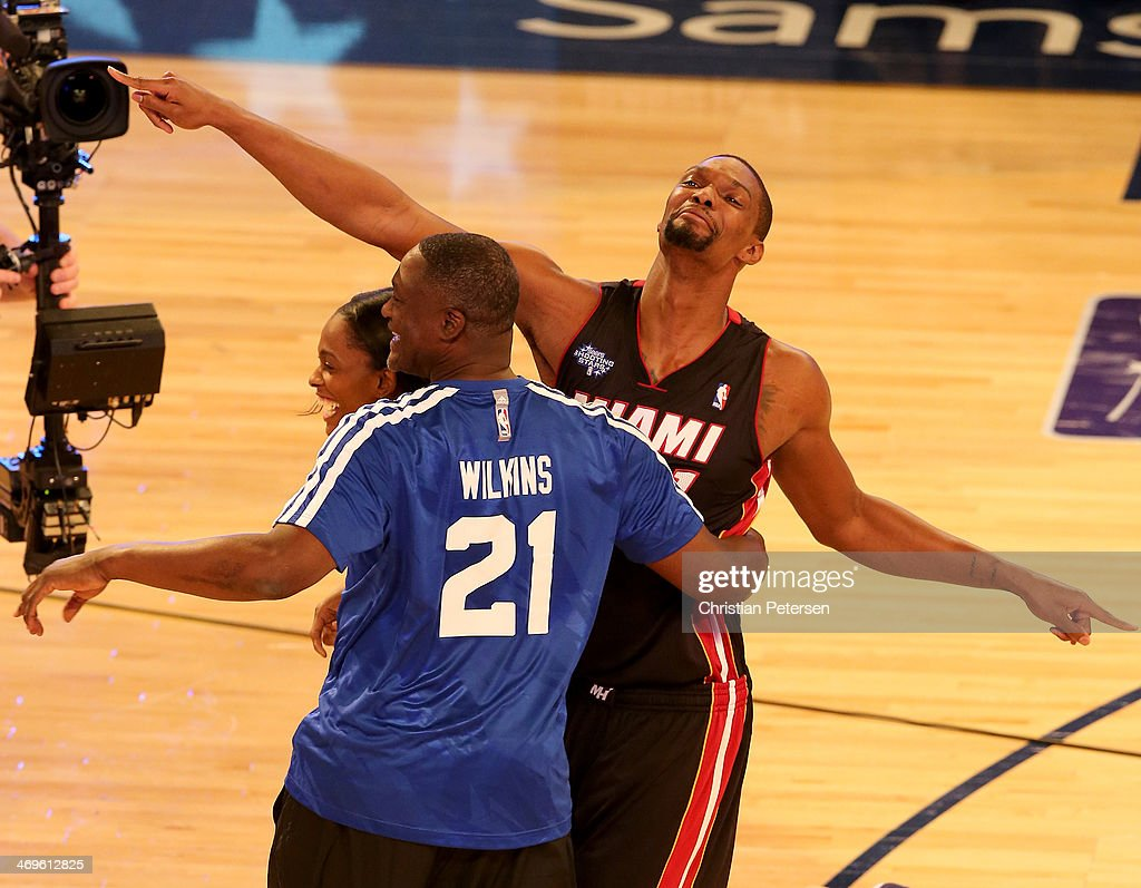 Eastern Conference All-Star <a gi-track='captionPersonalityLinkClicked' href=/galleries/search?phrase=Chris+Bosh&family=editorial&specificpeople=201574 ng-click='$event.stopPropagation()'>Chris Bosh</a> #1 of the Miami Heat Eastern Conference All-Star Legend <a gi-track='captionPersonalityLinkClicked' href=/galleries/search?phrase=Dominique+Wilkins&family=editorial&specificpeople=204510 ng-click='$event.stopPropagation()'>Dominique Wilkins</a> and Eastern Conference WNBA All-Star <a gi-track='captionPersonalityLinkClicked' href=/galleries/search?phrase=Swin+Cash&family=editorial&specificpeople=202486 ng-click='$event.stopPropagation()'>Swin Cash</a> #8 of the Chicago Sky celebrate their win during the Sears Shooting Stars Competition 2014 as part of the 2014 NBA All-Star Weekend at the Smoothie King Center on February 15, 2014 in New Orleans, Louisiana.