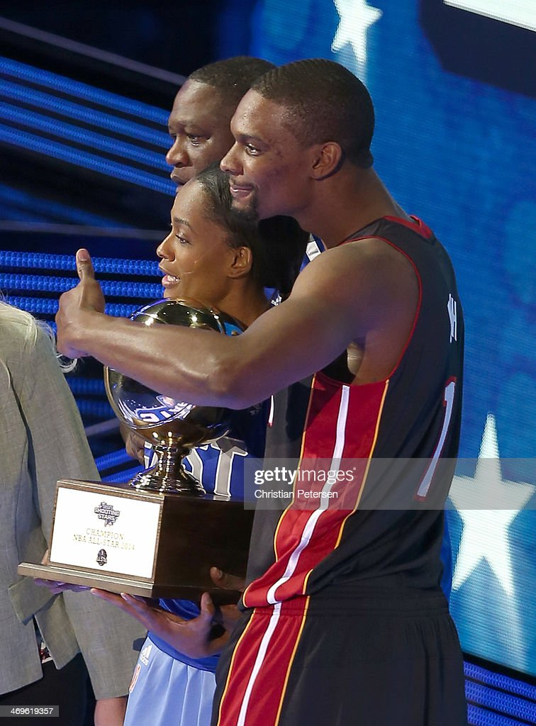 Eastern Conference All-Star Chris Bosh #1 of the Miami Heat Eastern Conference All-Star Legend Dominique Wilkins Eastern Conference WNBA All-Star Swin Cash #8 of the Chicago Sky accept a trophy for winning the Sears Shooting Stars Competition 2014 as part of the 2014 NBA All-Star Weekend at the Smoothie King Center on February 15, 2014 in New Orleans, Louisiana.
