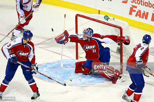 Eastern Conference AllStar goalie Carey Price of the Montreal Canadiens attempts to make a save against Western Conference AllStars during the 2009...