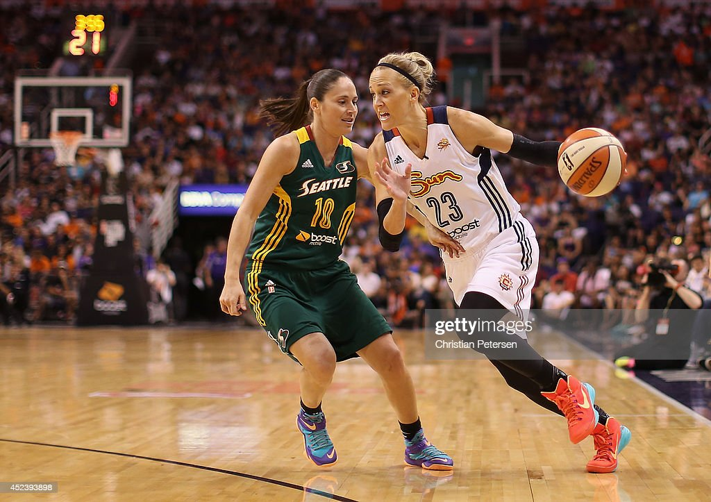 Eastern Conference AllStar Katie Douglas of the Connecticut Sun drives the ball past Western Conference AllStar Sue Bird of the Seattle Storm during...