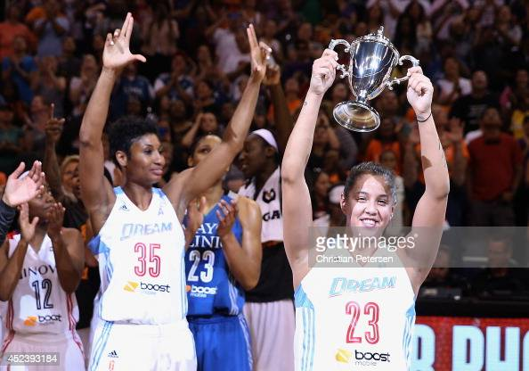 Eastern Conference AllStar Shoni Schimmel of the Atlanta Dream celebrates with the MVP trophy after defeating the Western Conference AllStars 125124...