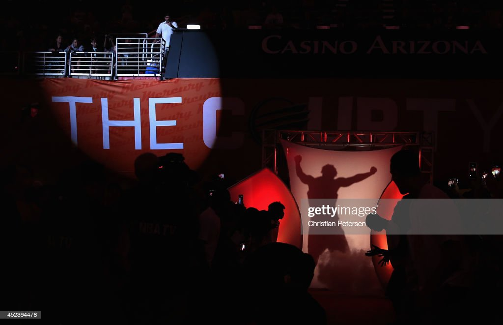 Eastern Conference AllStar Tamika Catchings of the Indiana Fever is introduced to the WNBA AllStar Game at US Airways Center on July 19 2014 in...