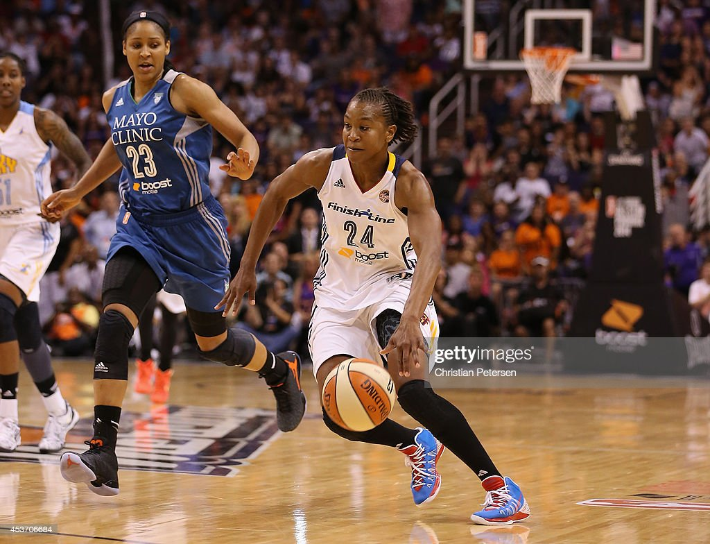 Eastern Conference All-Star <a gi-track='captionPersonalityLinkClicked' href=/galleries/search?phrase=Tamika+Catchings&family=editorial&specificpeople=202220 ng-click='$event.stopPropagation()'>Tamika Catchings</a> #24 of the Indiana Fever handles the ball during the WNBA All-Star Game at US Airways Center on July 19, 2014 in Phoenix, Arizona. The East defeated the West 125-124 in overtime.