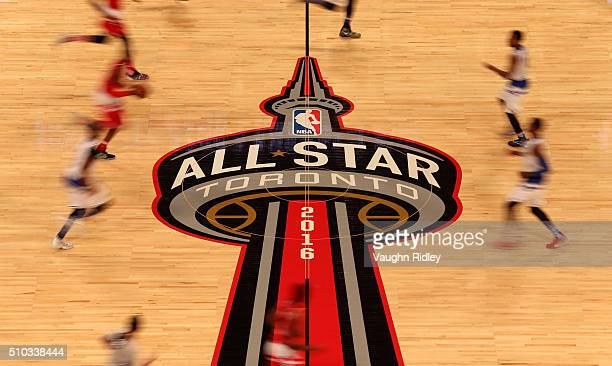 Eastern Conference and Western Conference players run past center court in the first half during the NBA AllStar Game 2016 at the Air Canada Centre...