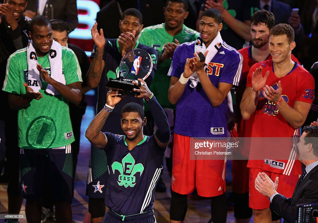 Eastern Conference Kyrie Irving #2 of the Cleveland Cavaliers holds up the KIA MVP trophy following the 2014 NBA All-Star game against the Western Conference at the Smoothie King Center on February 16, 2014 in New Orleans, Louisiana. The East defeated the West 163-155.