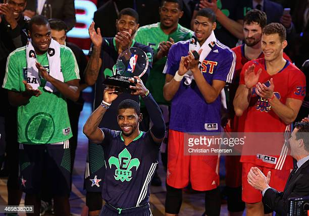 Eastern Conference Kyrie Irving of the Cleveland Cavaliers holds up the KIA MVP trophy following the 2014 NBA AllStar game against the Western...