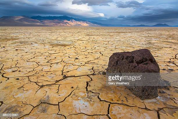USA, Eastern Oregon, Alvord Playa, Stormy clouds over cracked earth