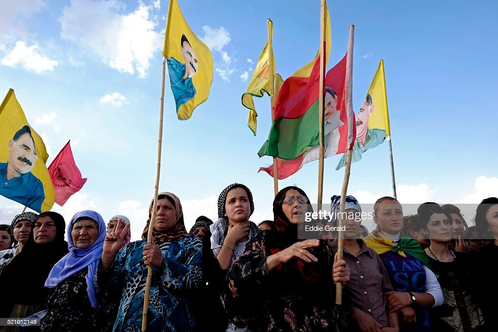 Eastern Syria - Dyrek 15 October 2014 People taking part in the funeral of a YPG kurdish fighter killed in battle with ISIS Islamic militants at the cemetery for YPG and YPJ Kurdish fighters near the town of Dyrek in Rojava Kurdish control zone.