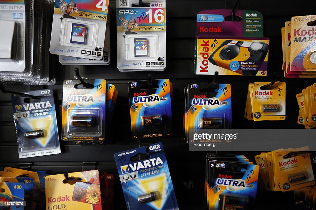 Eastman Kodak Co. lithium batteries and disposable cameras are displayed for sale next to digital memory cards at a Kodak Image Center Solutions location in Glendale, California, U.S., on Tuesday, Nov. 12, 2013. Eastman Kodak is scheduled to release earnings figures on Nov. 14. Photographer: Patrick T. Fallon/Bloomberg via Getty Images