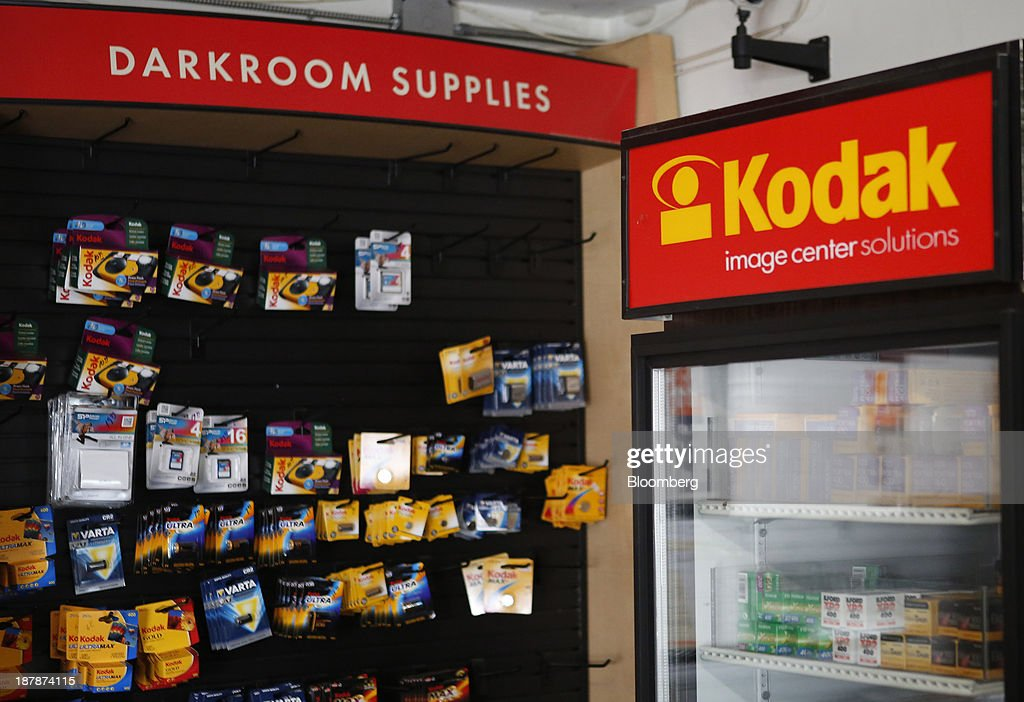 Eastman Kodak Co. signage is displayed next to disposable cameras, batteries, and film for sale at a Kodak Image Center Solutions location in Glendale, California, U.S., on Tuesday, Nov. 12, 2013. Eastman Kodak is scheduled to release earnings figures on Nov. 14. Photographer: Patrick T. Fallon/Bloomberg via Getty Images