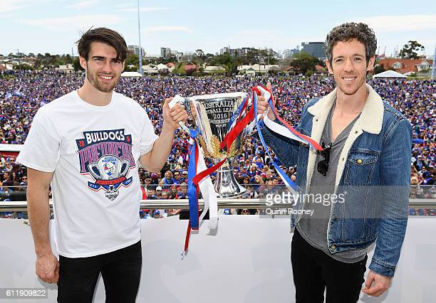 Easton Wood and Robert Murphy of the Bulldogs pose with the trophy tduring the Western Bulldogs AFL Grand Final celebrations at Whitten Oval on...