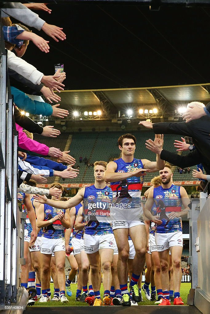 Easton Wood of the Bulldogs and his teammates leave the field after winning the round 10 AFL match between the Collingwood Magpies and the Western Bulldogs at Melbourne Cricket Ground on May 29, 2016 in Melbourne, Australia.
