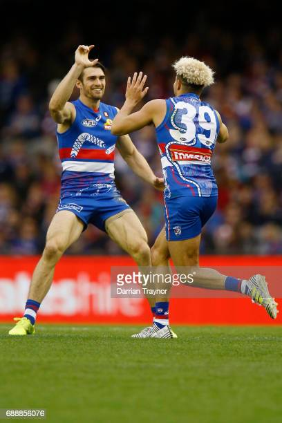 Easton Wood of the Bulldogs and Jason Johannisen celebrate a goal during the round 10 AFL match between the Western Bulldogs and the St Kilda Saints...