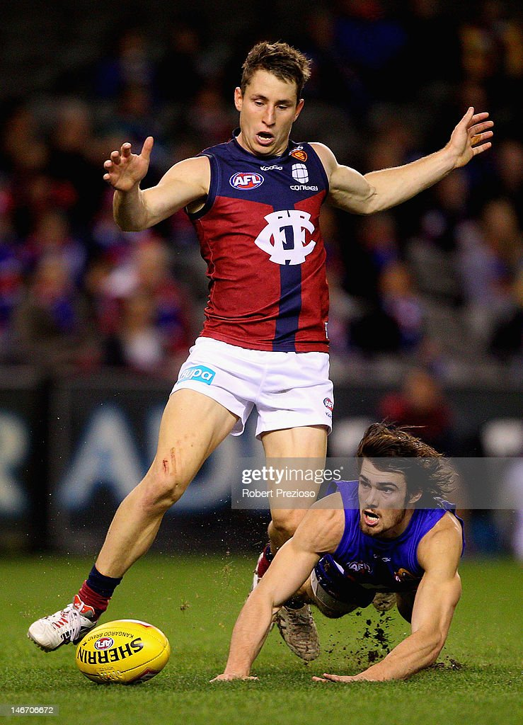Easton Wood of the Bulldogs dives for a mark during the round 13 AFL match between the Western Bulldogs and the Brisbane Lions at Etihad Stadium on June 23, 2012 in Melbourne, Australia.