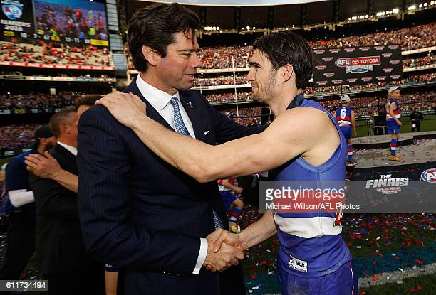 Easton Wood of the Bulldogs is congratulated by Gillon McLachlan Chief Executive Officer of the AFL during the 2016 Toyota AFL Grand Final match...