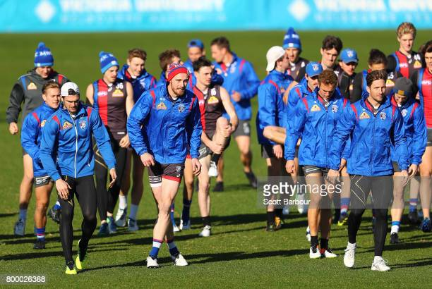 Easton Wood of the Bulldogs Jordan Roughead of the Bulldogs and Matthew Boyd of the Bulldogs run during a Western Bulldogs AFL training session at...