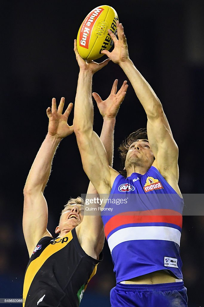 Easton Wood of the Bulldogs marks infront of Jack Riewoldt of the Tigers during the round 16 AFL match between the Western Bulldogs and the Richmond...