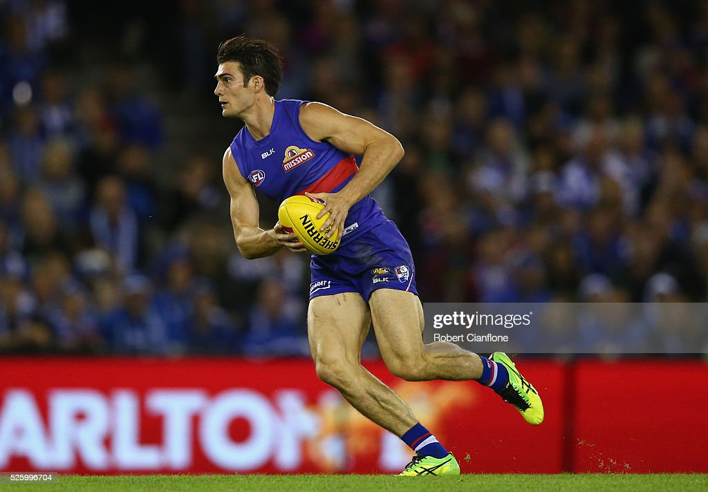 Easton Wood of the Bulldogs runs with the ball during the round six AFL match between the North Melbourne Kangaroos and the Western Bulldogs at Etihad Stadium on April 29, 2016 in Melbourne, Australia.