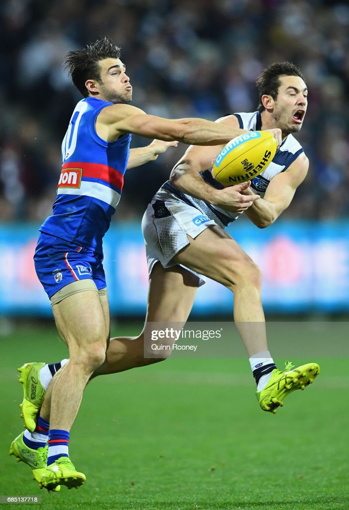 Easton Wood of the Bulldogs spoils a mark by Daniel Menzel of the Cats during the round nine AFL match between the Geelong Cats and the Western Bulldogs at Simonds Stadium on May 19, 2017 in Geelong, Australia.