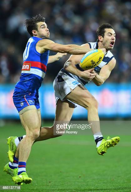 Easton Wood of the Bulldogs spoils a mark by Daniel Menzel of the Cats during the round nine AFL match between the Geelong Cats and the Western...