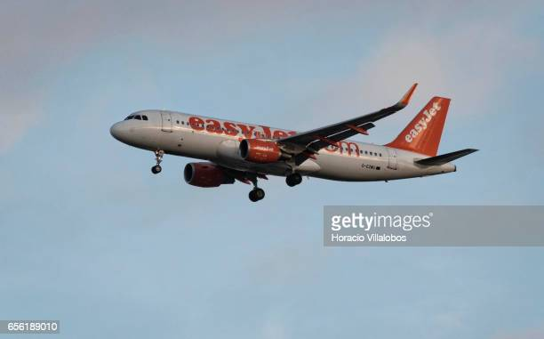 EasyJet Airbus A320200 flies on its descent path into Humberto Delgado Airport on March 20 2017 in Lisbon Portugal EasyJet is a British budget...