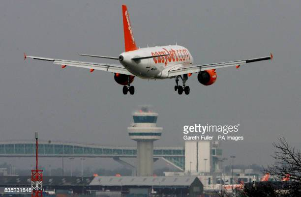ONE A easyJet passenger plane lands at Gatwick Airport in West Sussex as BAA are forced to sell the site and break their monopoly on airport sites...