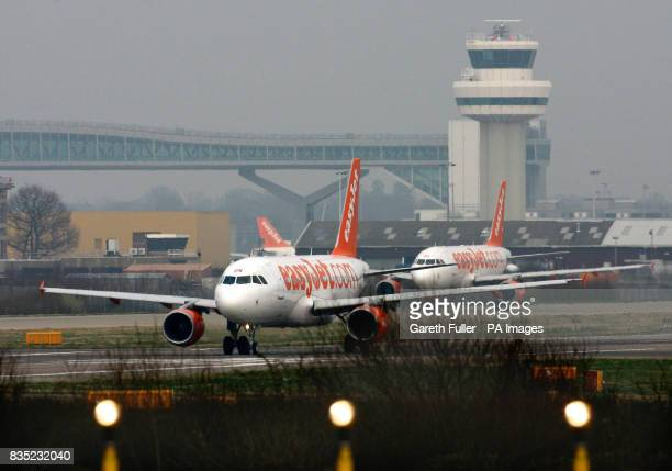 ONE EasyJet planes prepare to take off from Gatwick Airport in West Sussex as BAA are forced to sell the site and break their monopoly on airport...