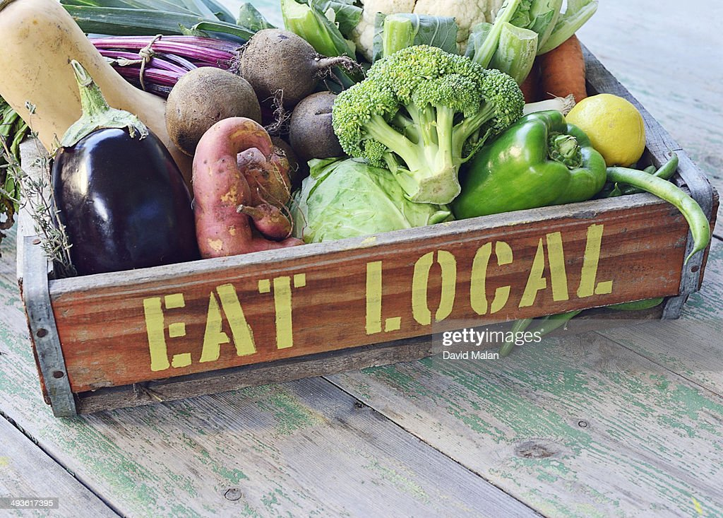 'Eat local' printed on a crate of vegetables