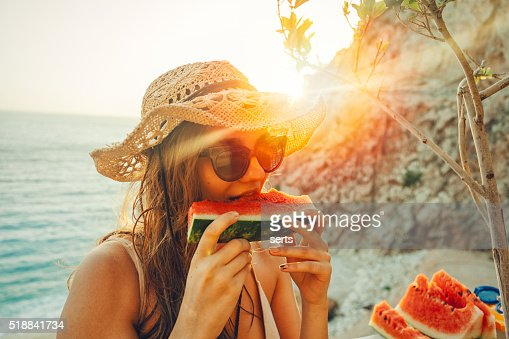 Eating and enjoying watermelon