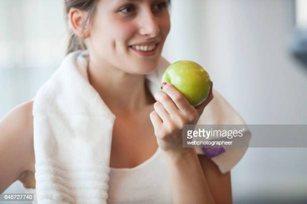 Eating apple on workout break