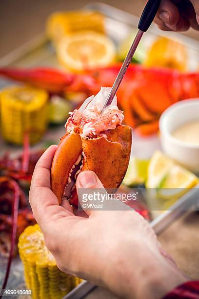 Eating Delicious Cooked Lobster with Seafood Utensil