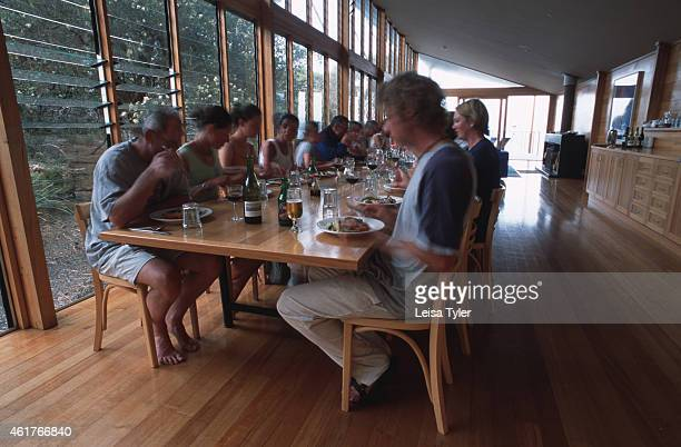 Eating dinner at 'The Lodge' a friendly environmentally sustainable hotel inside the Mount William National Park on Tasmania's East Coast Built from...