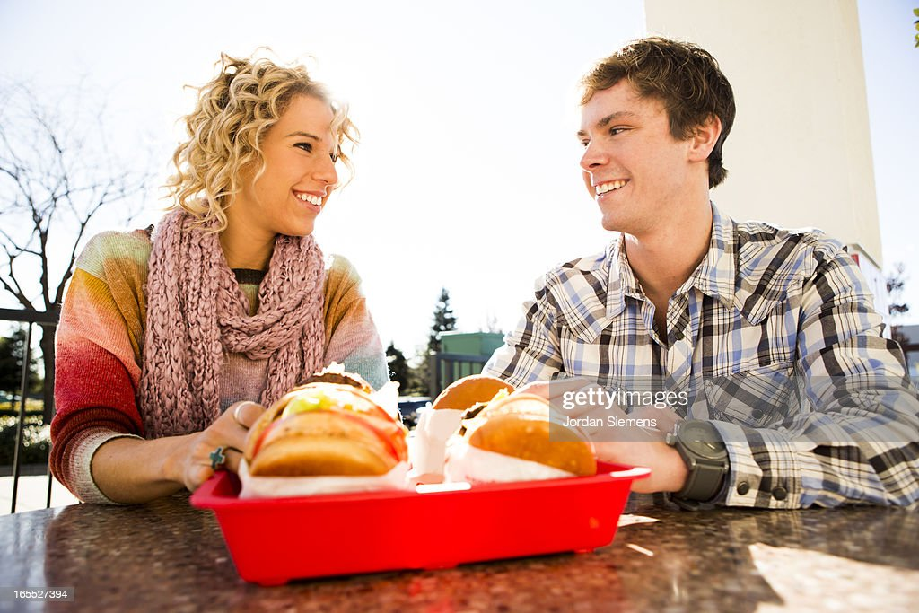 Eating fast food hamburgers : Stock Photo