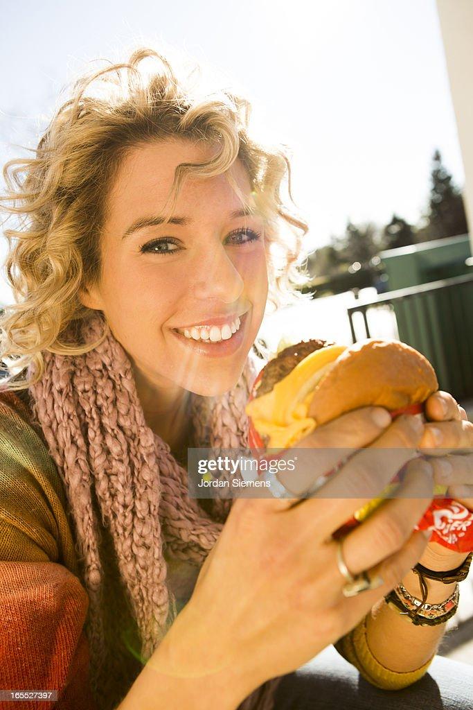 Eating fast food hamburgers : Stock Photo