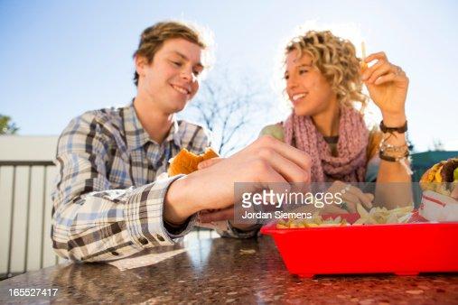 Eating fast food hamburgers