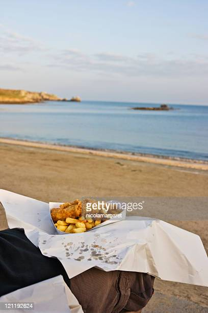 Eating fish and chips on the beach