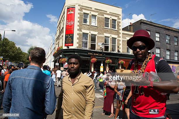 Eating jerk chicken on Monday 28th August 2016 at Notting Hill Carnival in West London A celebration of West Indian / Caribbean culture and Europe's...