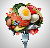 Eating ketogenic food and Keto nutrition lifestyle diet low carb and high fat meal as fish nuts eggs meat avocado and other healthy ingredients as a therapeutic snacks on a fork with 3D illustration e