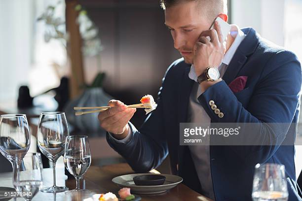 Eating sushi and talking on mobile phone