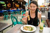 Eating Thai Food on Khao San Road Bangkok Thailand