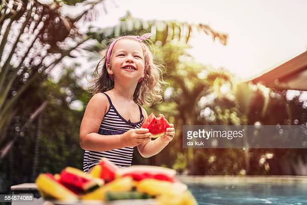 Eating watermelon in swimming pool