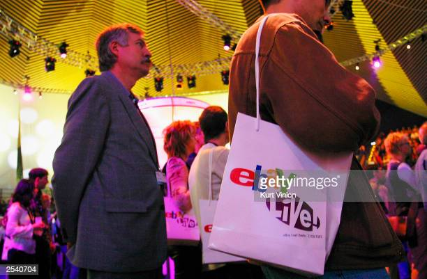 Ebay fans carrying gift packs watch entertainers at an Ebay Live event on September 27 2003 in Berlin Germany Ebay Germany held an Ebay Live event...