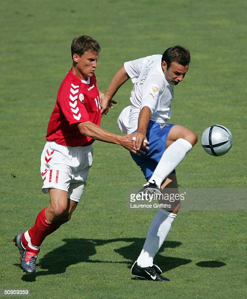 Ebbe Sand of Denmark battles for the ball with Cristian Zanetti of Italy during the UEFA Euro 2004 Group C match between Denmark and Italy at the...