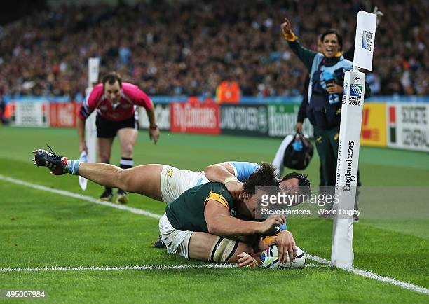 Eben Etzebeth of South Africa goes over to score their second try during the 2015 Rugby World Cup Bronze Final match between South Africa and...