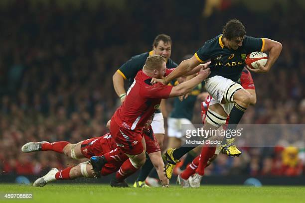 Eben Etzebeth of South Africa pulls away from Samson Lee of Wales during the International match betwwen Wales and South Africa at the Millennium...