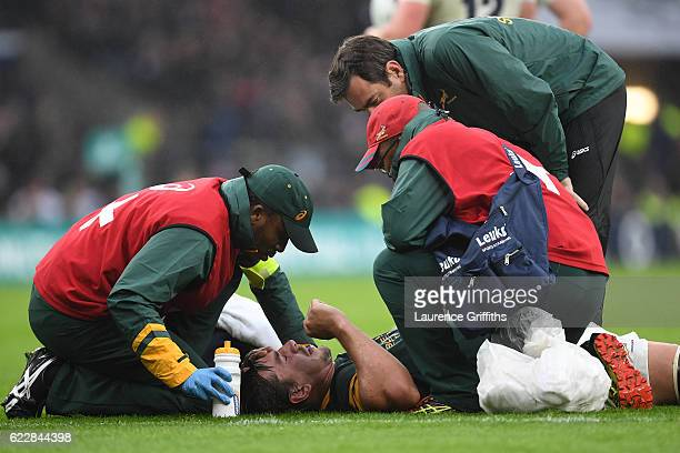 Eben Etzebeth of South Africa receives medical treatment during the Old Mutual Wealth Series match between England and South Africa at Twickenham...