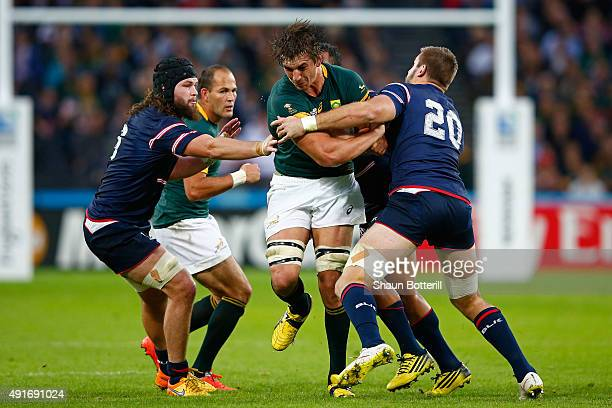 Eben Etzebeth of South Africa runs into Cam Dolan of the United States during the 2015 Rugby World Cup Pool B match between South Africa and USA at...